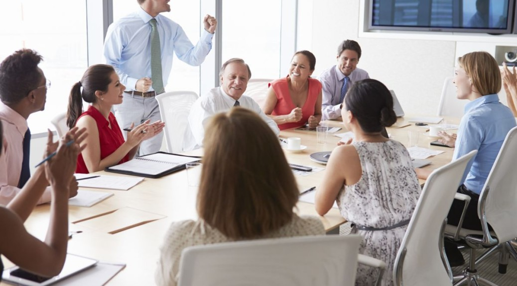 Man Leading an Enthusiastic Business Meeting