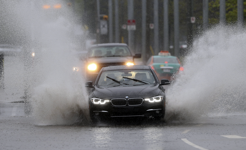 Car Splashing in a Puddle During a Rain Storm