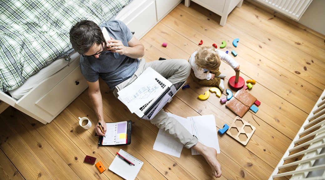 A man is working from home with a child